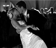 Bride & Groom Kissing at the end of their first dance together.
