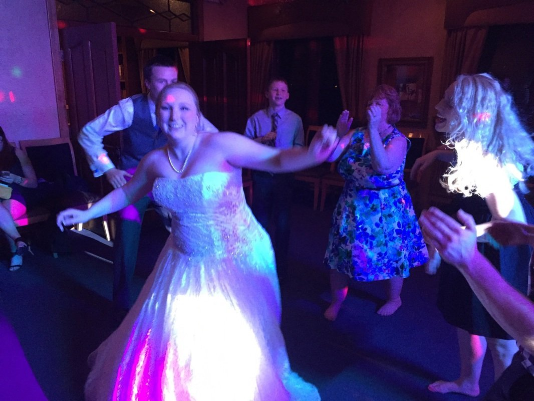 Lora dancing the night away at her wedding!