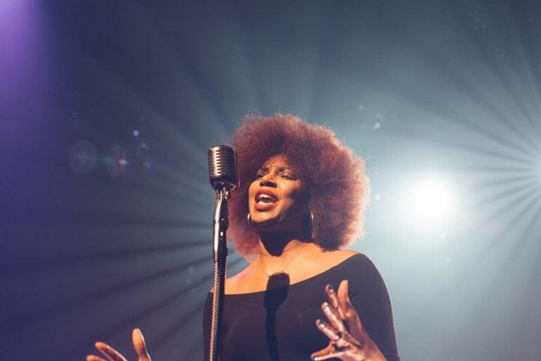 Female black singer singing a love song.